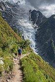 Hiker on hiking trail, Glacier de Taconnaz, view from the hike La Jonction, Chamonix, Haute-Savoie, France, Europe