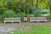 Wooden benches in a garden in autumn, Somme, France