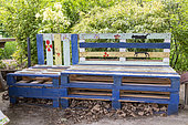 Garden bench made with recycled pallets, spring, Pas de Calais, France
