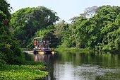 Cruise ship on a waterway through dense vegetation, Rio Miranda, southern Pantanal, Matto Grosso do Sul, Brazil, South America