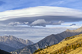 Lenticular cloud over the Ubaye valley in autumn, Alpes de Haute Provence, France