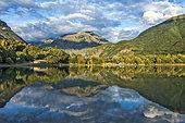 Reflection of the mountains on the lake of Valbonnais, Matheysine, Parc National des Ecrins, Isère, Auvergne Rhône Alpes, France