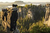 View of the Bastei with Wehlnadel and Wehlgrund to the Lilienstein at sunrise, Saxony, Germany, Elbe Sandstone Mountains, Saxon Switzerland National Park, Europe