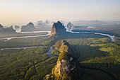 Aerial view, mangrove forest with meandering river and high karst rocks during sunrise, Ao Phang-Nga National Park, Phang-Nga Province, Thailand, Asia