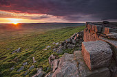 Sunset at Stanage Edge, UK. The sun sets over Stanage Edge in the Peak District, UK.