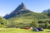 Tents on camping site by the lake Litlvatnet in the high valley Innerdalen, mountain Innerdalstårnet, Trollheimen Mountain Area, Sunndal, Møre og Romsdal, Vestlandet, Norway, Europe