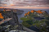 Sunset with dramatic clouds, view from the top of Hermannsdalstinden, fjords, lakes and mountains, Moskenesøya, Lofoten, Nordland, Norway, Europe