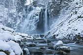 The Heidenbad waterfall in winter, Thur river, Alsace, France