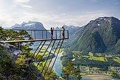 Hikers standing on viewing platform Rampestreken, hiking Romsdalseggen, river Rauma, Romsdalfjellene mountains, Andalsnes, Møre og Romsdal, Norway, Europe
