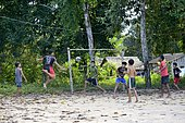 Teenagers playing football, Pimental, district Itaituba, Pará state, Brazil, South America *** IMPORTANT: Use by development aid organizations in Germany only after consultation. ***