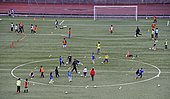 Children in colorful clothes on a sports field, during soccer practice, Canton of Geneva, Switzerland, Europe