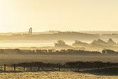 Village of Audinghen in the mist at sunrise, Opal Coast, Hauts de France, France