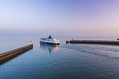 Ferry leaving the port of Calais at dawn, Côte d'Opale, Hauts-de-France, France