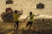 Teenager playing soccer, children, city beach of Tarrafal, São Nicolau, Cape Verde, Africa
