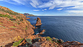 The creeks of Cap Dramont, in the Esterel Massif. A small classified and protected massif created by a volcanic activity dating from the Permian (primary era) and formed by rhyolites (porphyries) with brilliant colours under the setting sun. Var, France