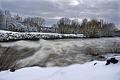 River Allan in flood under the snow, Etupes, Doubs, France