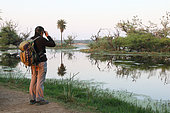 Birdwatching at the edge of a swamp in the evening, Keoladeo NP North West India