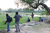 Wildlife photographers at the edge of a swamp Keoladeo NP, North West India