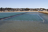 Seawater pool filling up with the tide in Binic, Côtes-d'Armor, Brittany, France