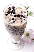 Pearl milk tea or Boba milk tea, drink made by adding boba balls, made from a mixture of tapioca and carrageenan powder, to shaken milk black tea