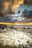 Sea foam on the beach of Sangatte, Opal Coast, Pas-de-Calais, France