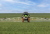 Chemical treatment of crops with very wide spreading behind a tractor, field crops, agricultural territories, Senlis region, Department of Oise, France