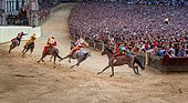 The Palio di Siena horse race on Piazza del Campo, Siena, Tuscany, Italy, Europe