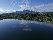 Aerial view of Lake Varese and the Campo dei Fiori mountain range, Varese, Italy.