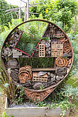 Rocambole gardens, Artistic vegetable and botanical gardens in organic farming, A meeting between art and Nature, Insect hotel against a wall , insect shelter made of different materials, La Lande aux Pitois, Corps Nuds, Ille-et-Vilaine (35), Brittany, France