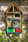 Insect hotel against a wall , insect shelter made of different materials, Rocambole gardens, Artistic vegetable and botanical gardens in organic farming, A meeting between art and Nature, La Lande aux Pitois, Corps Nuds, Ille-et-Vilaine (35), Brittany, France