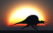A silhouetted Spinosaurus sprinting against a setting Sun at the end of another Jurassic day.