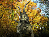 A one ton, 20 foot long Diabloceratops wanders a Cretaceous forest 70 million years ago in what is today Utah. . Like the better known Triceratops, Diabloceratops was a Ceratopsid, a large four-legged plant-eating dinosaur characterized by beaks, rows of shearing teeth in the back of the jaw, and elaborate horns and frills. While they resemble defensive shields, the frills are in fact relatively fragile, suggesting that they may have served a purpose other than protecting against a brute force attack. One possibility is that the frills were employed as visual displays in order to intimidate rivals and attract the opposite sex.