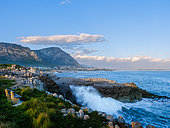 View across Walker Bay from Sievers Point with one of the many benches on the Cliff Path. Kleinrivier Mountains in the background. Hermanus. Whale Coast. Overberg. Western Cape. South Africa