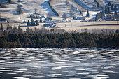Frozen Lac des Rousses, view of Les Plans, Les Rousses, Jura, France