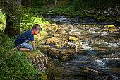 Boy on the bank, Source du Doubs, Mouthe, Doubs, France