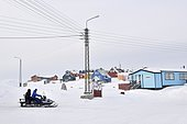 Snowmobile in front of Qeqertarsuaq, Disko Island, Greenland, Arctic North America, North America