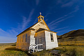 October 9, 2011 - The old pioneer church in Dorothy, Alberta, Canada, on a starry night illuminated by moonlight.