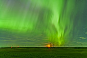 June 29, 2013 - The northern lights as seen from the Wintering Hills Wind Farm near Drumheller, Alberta, Canada. The moon is just rising as the display is reaching a peak in intensity.