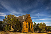 January 27, 2015 - A moonlit nightscape of the historic Hearst Church in Pinos Altos, New Mexico, at 7000 feet altitude (thus the name High Pines) and on the Continental Divide. In the sky above, the Big Dipper is at right, and Polaris is at left over the church.