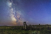 August 27-28, 2014 - Mars (bottom) and Saturn in conjunction at right, and the Milky Way at left, in deep blue twilight over the old corral of the 76 Ranch in Grasslands National Park, Saskatchewan, Canada. Antares and Scorpius are just behind the corral gate at right, Sagittarius is at left in the Milky Way. M6 and M7 open clusters are visible at left.