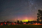 August 10, 2018 - The Perseid meteor shower over the Saskatchewan Summer Star Party, with an aurora as a bonus. . The view is looking north with Polaris at top centre, and the Big Dipper at lower left. The radiant point in Perseus is at upper right. . . The sky also has bands of green airglow, which was more prominent in images taken earlier before the short-lived aurora kicked up. The aurora was not obvious to the naked eye. However, the northern sky was bright all night with the airglow and faint aurora.