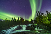 September 8, 2019 - The northern lights over the waterfalls known as the Ramparts on the Cameron River east of Yellowknife, Northwest Territories, Canada. The aspen trees are turning yellow on this September evening. This is looking northeast toward Perseus and Andromeda. M31 is at top centre.