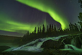 September 8, 2019 - Curtains of aurora over the Ramparts Falls on the Cameron River near Yellowknife, Northwest Territories, Canada.