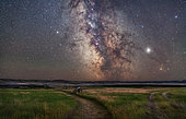 August 27, 2019 - The core of the Milky Way in Sagittarius low in the south over the Frenchman River valley at Grasslands National Park, Saskatchewan, Canada. This is from the 76 Ranch Corral site. Grasslands is a Dark Sky Preserve. . . The frame takes in the open star clusters M6 and M7 just above the horizon in Scorpius, on up through the Sagittarius Star Cloud and galactic core, then up past the red nebulas M8 and M20, the Small Sagittarius Starcloud M24 flanked by the clusters M23 and M25, then the nebulas M17 and M16 at top in Serpens. The globular cluster M55 is visible at far left. . . Jupiter is bright at right above reddish Antares, Saturn is dimmer at left, to the left of the globular cluster M22.