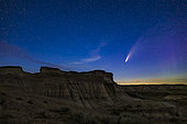 Comet NEOWISE (C/2020 F3) over some of the eroded hoodoo formations at Dinosaur Provincial Park, Alberta, Canada, July 14-15, 2020. A faint aurora is at right. The foreground is lit by starlight only.