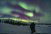 March 18, 2020 - A couple watches an aurora display in Churchill, Manitoba, Canada. Arcturus is the bright star at right in the northeast.