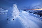 Sunset on the summit of Toviktinden Mountain, Norway.