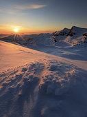 Midnight Sun above Lilletinden Mountain, Nordland, Norway.