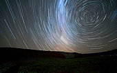 Star trails around the south celestial pole, Somuncura, Argentina. The Milky Way is also visible trailing in the long exposure.