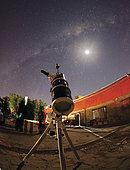 Astrophotography setup with the moon and the Milky Way in the background, Doyle, Argentina.